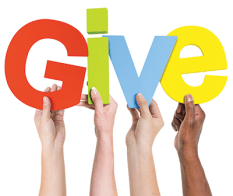 Four hand hold up a for letters that spell Give. Charity foundations are available for those who want to give to the coronavirus victims.