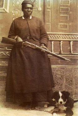 Stagecoach Mary with a rifle and her dog