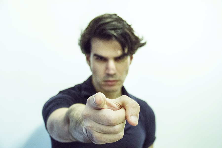 A man pointing his finger so lay blame.