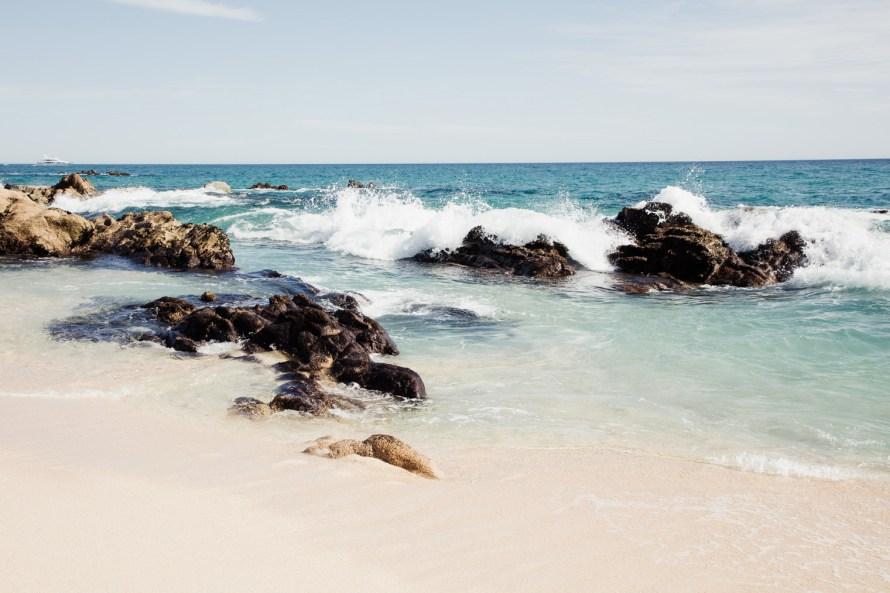 Waves against rocks Hilton Los Cabos Beach & Golf Resort
