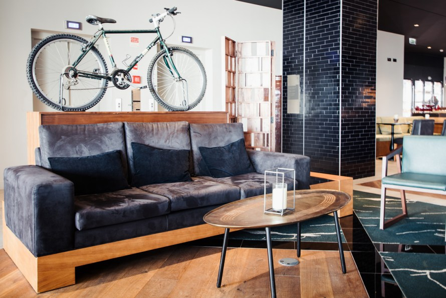 Couch and bike at Azor Hotel