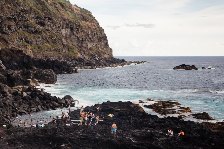Volcanic coastline and hot springs pool