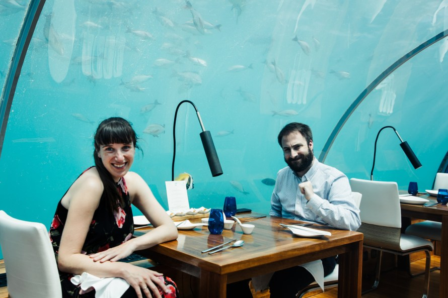 Carly and Jake at a table at Ithaa undersea restaurant