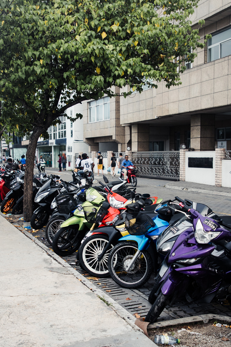 Colorful motorbikes lined up on the street