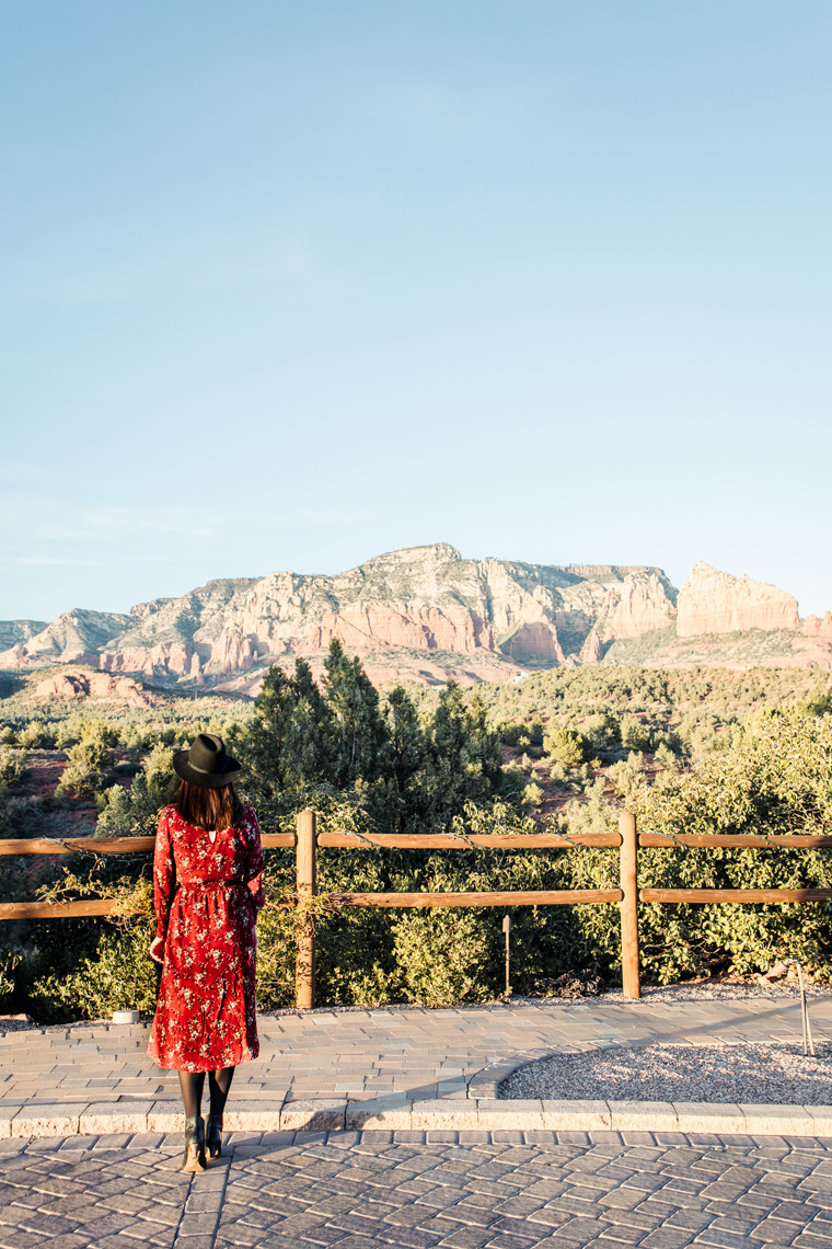 Carly in front of red rocks