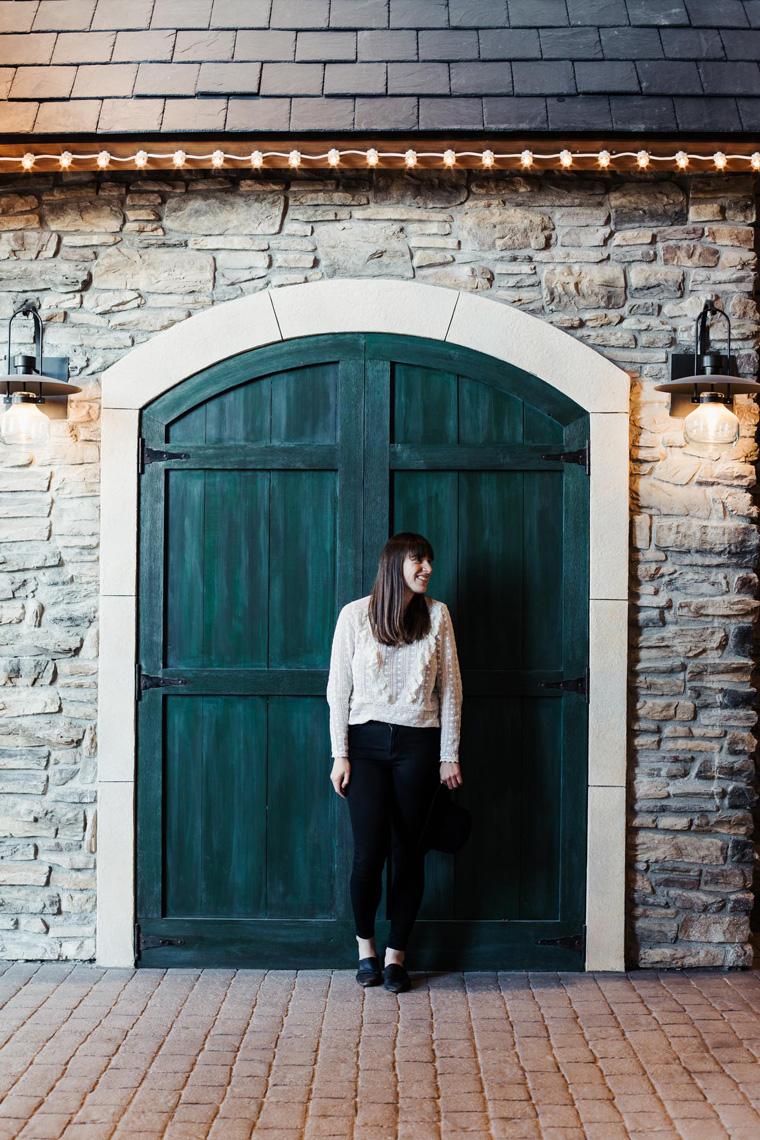 Carly in front of green door