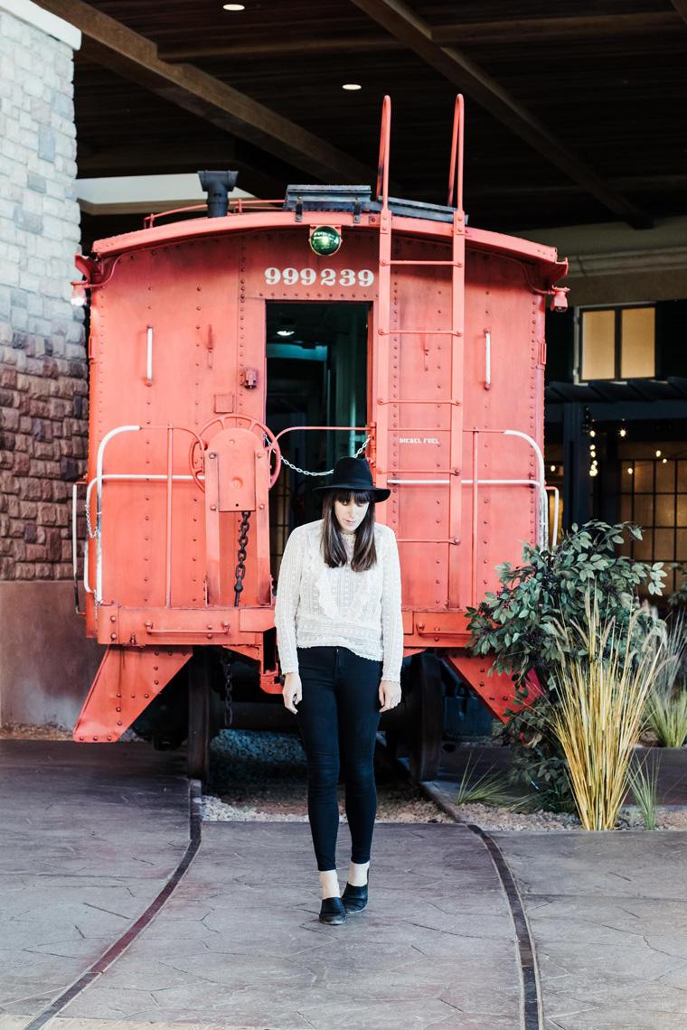 Carly by train car in Gaylord Rockies Resort lobby