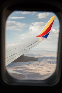Window seat view of plane wing