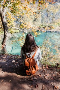 Carly sitting in Plitvice Lakes National Park