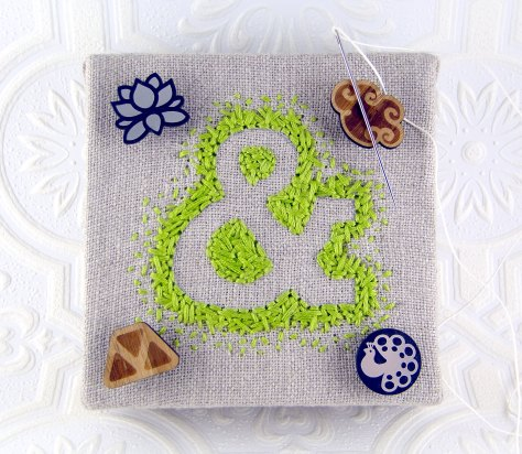 I got this great ampersand embroidery from OhHiShop.  Sadly, she's not embroidering any longer!