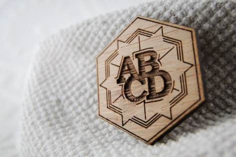 A close-up of the heads side shows off the ABCD logo and a fairly random line design.