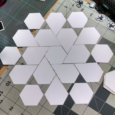 Expanded twirling bloom, trying to find a good repeat point.  When cutting the jewel shapes, you get triangles as well (not pictured)!