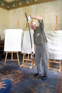 Scott Sherwood, Art conservator.  He's unsheathed the sword in one motion, as is proper for a katana.