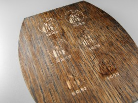 The initial test engravings were not visible enough against the strong contrast of the wood grain.