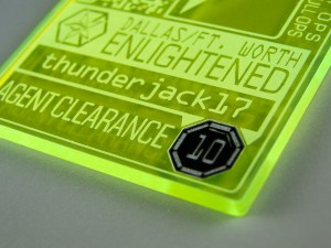 The sticker sits in a deeper engraving on the badge so that it's protected from accidentally being removed.