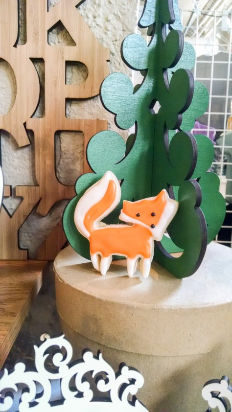 Adorable Cookie by Dough and A Dear with and abecediary and small tree as backdrop
