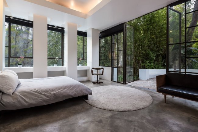 the-home-has-three-bedrooms-and-three-baths-this-bedroom-features-full-height-doors-leading-to-an-outdoor-terrace