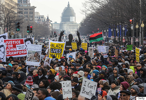 WASHINGTON, DC - DEC13: Demonstrators listen to speeches at Freedom Plaza at the start of the March on Washington, December 13, 2014, in Washington, DC. (Photo by Evelyn Hockstein/For The Washington Post via Getty Images)