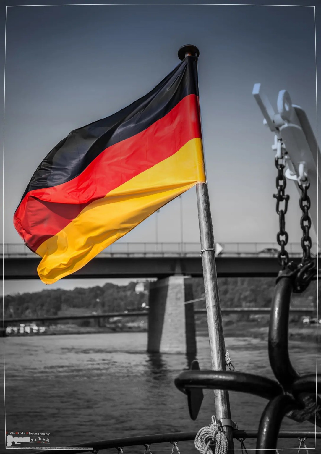 German national flag waving at the stern of a ship on the River Elbe