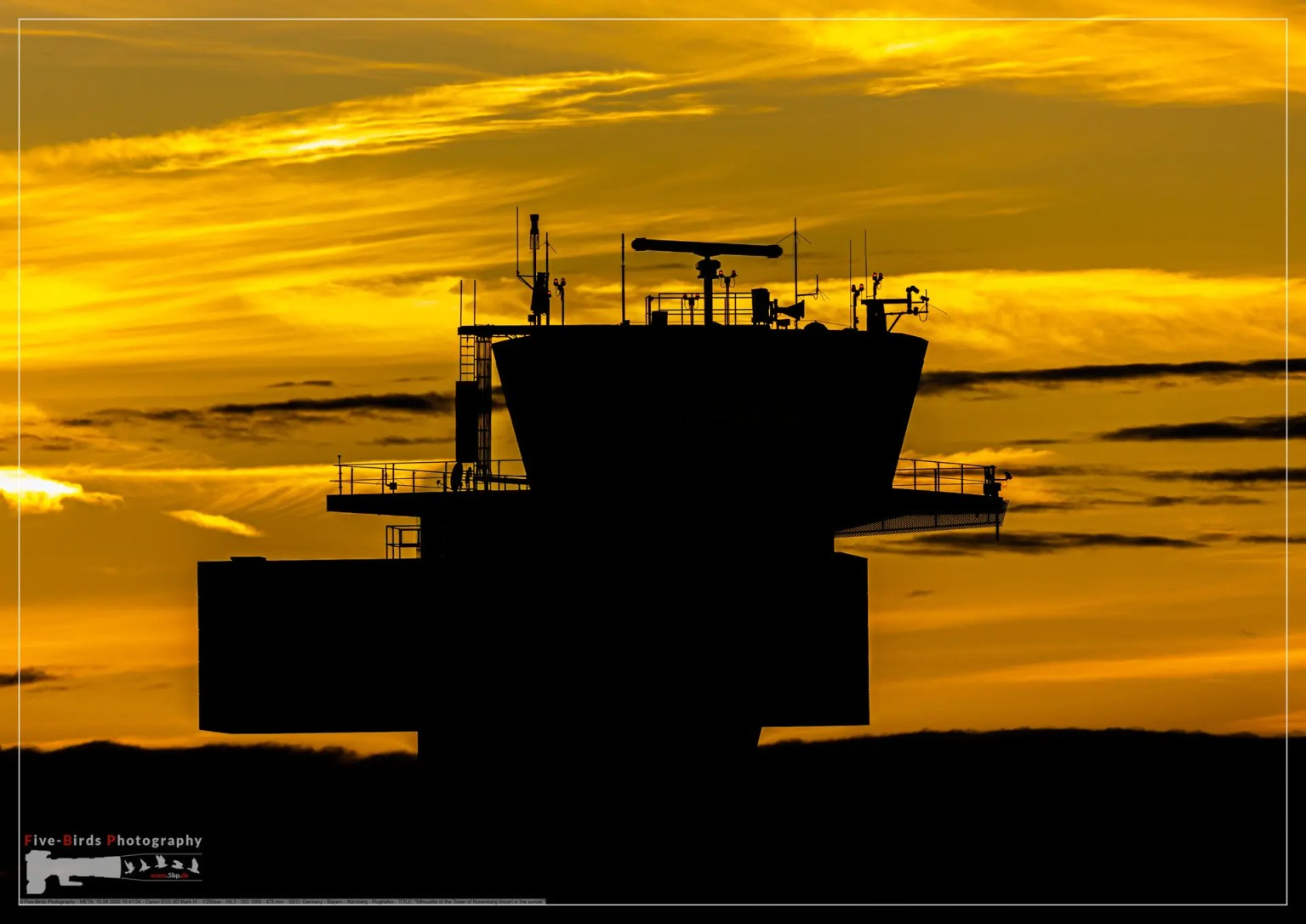 Silhouette of the Tower of Nuremberg Airport in the sunset
