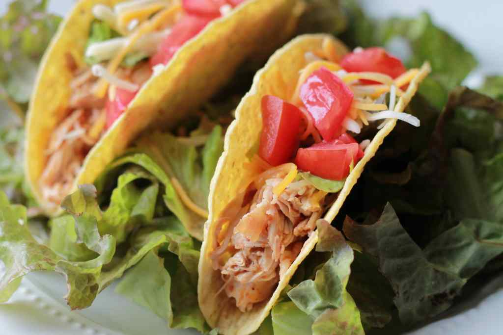 Easy SLOW COOKER Chicken Enchilada Tacos. We LOVE tacos and the slow cooker made these super easy to make. | 5dinners1hour.com