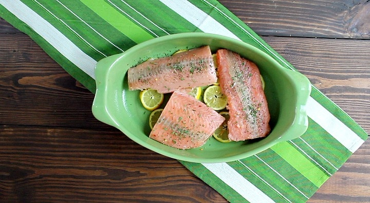 Easy one dish light and healthy salmon dinner prepared in a baking dish cooked over lemon slices |5dinners1hour.com