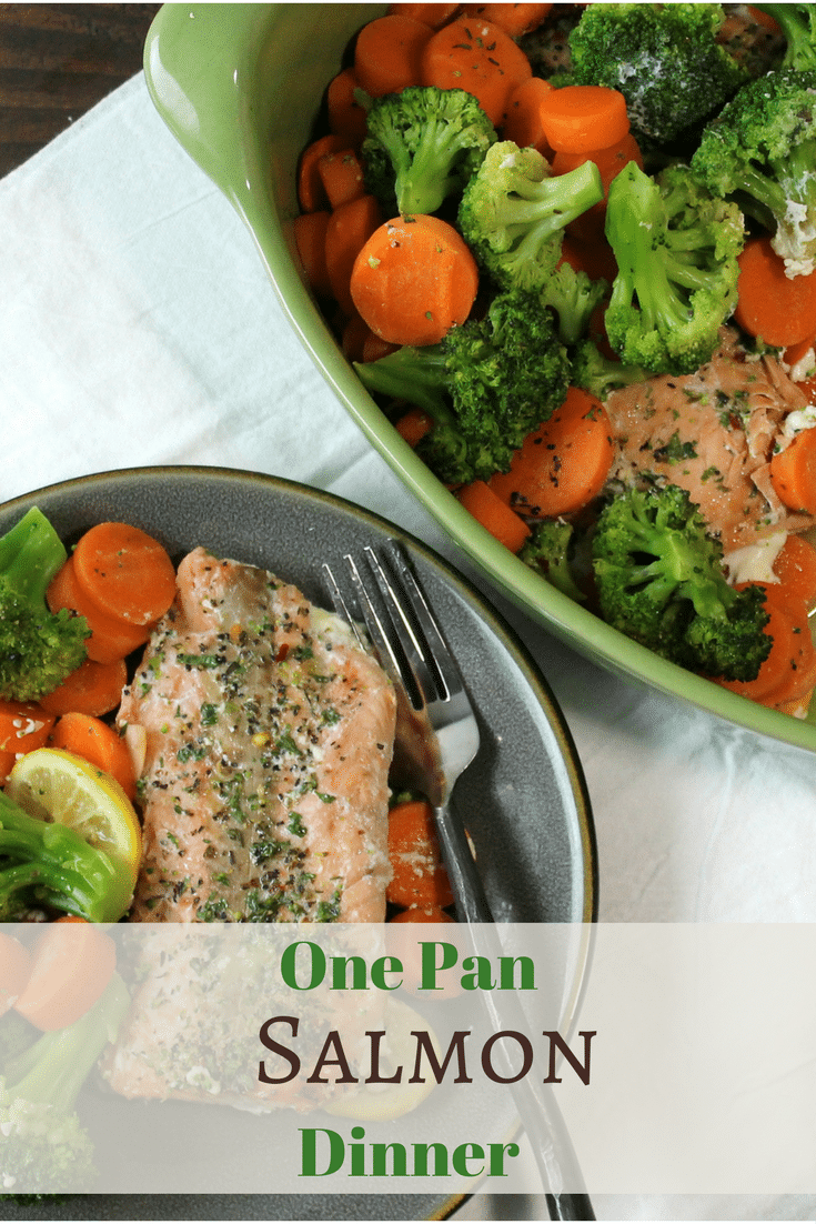 cooked and seasoned salmon with broccoli and sliced carrots served out of a green one dish & Light and Healthy Salmon Dinner - 5 Dinners In 1 Hour