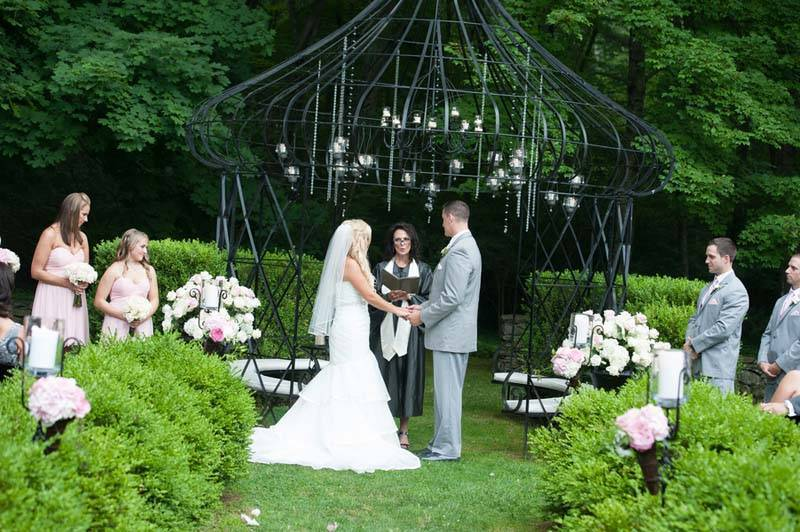 Bride and groom exchanging vows in garden