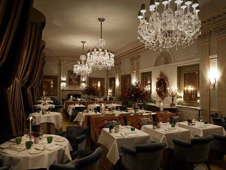 The Andre Garrett Restaurant by gorgeous candlelight. Photograph courtesy of Cliveden House