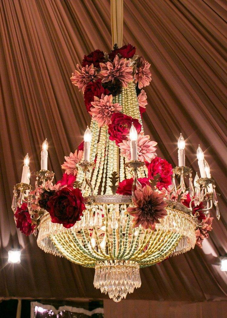 Dripping in crystals and accessorised with flowers - gorgeous chandeliers. Photo: White Lilac Inc