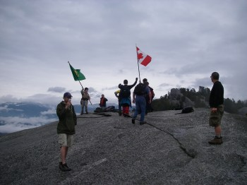 I've climbed a lot of mountains, but I've never seen THAT before! Gotta love it! Those flags will be visible for miles! We had other hikers ask to borrow the Canadian flag so they could have their pictures taken with it too.