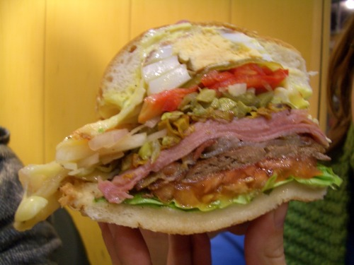 The Uruguayan Chivito A roast beef sandwich with lettuce, tomato, cheese, basil garlic mayo, hard boiled egg, pickles, red peppers, green olives, onions, ham, and bacon on a white bread bun. (Submitted by Phillip Penix-Tadsen)