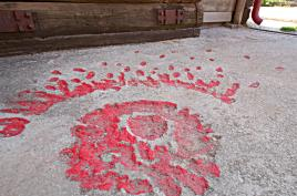 The roses of Sarajevo mark impact craters and shrapnel, using red paint.