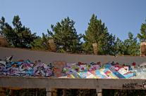 Streetart in Sarajevo: panorama of a part f the bobsleigh run