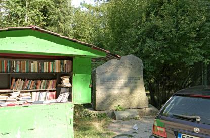 A public book exchange next to a small memorial for the partisan fighters of WW II