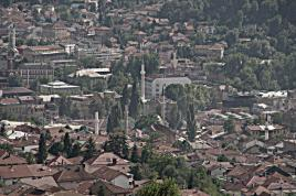 The old town of Sarajevo as seen from one the surrounding mountains. Half a dozen minarets in the company of the roman cathoic church of St. Anthony (left)