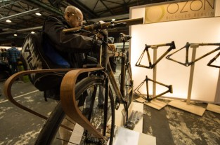 wooden bike parts at the booth of OZON Bicycles