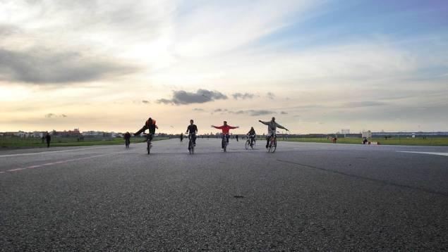 Cyclists at Tempelhof airport, Berlin