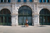 townhall Trieste with two young women passing by.