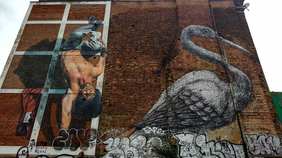 Two murals in London, a breakdancer and a heron by ROA