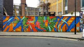 Colourful mural of a woman in a leotard with african print