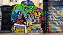 Mural of the 4 avengers reading a comic in London