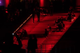 People chilling on the steps of Konzerthaus Berlin at Gendarmenmarkt during Festival of Lights