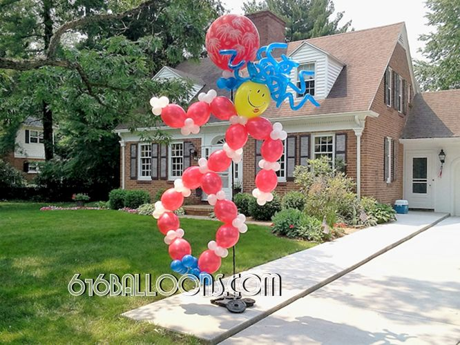 Smiley dancer balloon sculpture by 616Balloons.com Grand Rapids, Michigan. Premium balloon art & decor. Corporate or private parties & events