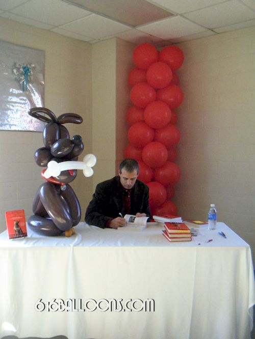 Balloon Dog & column balloon sculpture by 616Balloons.com with Author Jim Gorant Grand Rapids, Mi. Premium balloon art & decor. Corporate events, private parties..