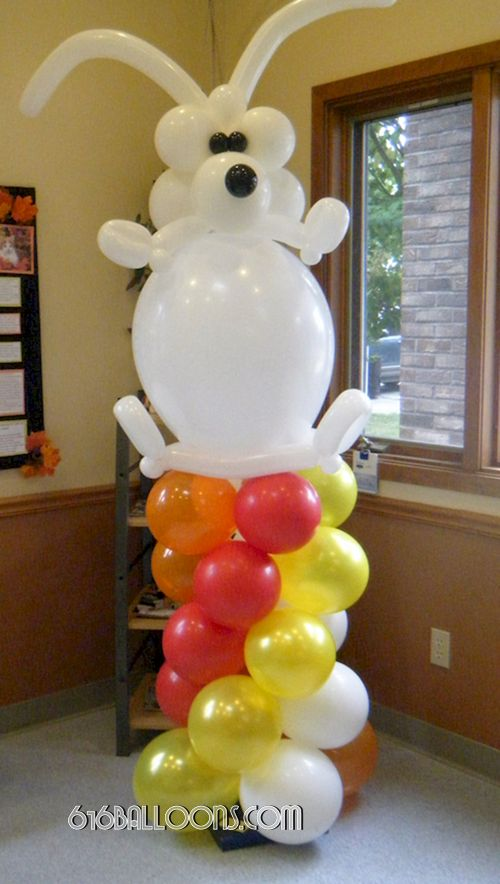 Big white balloon dog on column balloon sculpture by 616Balloons.com Grand Rapids, Mi. Premium balloon art & decor. Corporate events, private parties..
