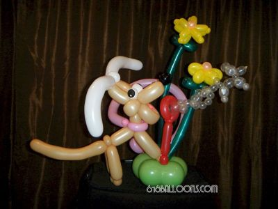 Balloon Dog blowing bubbles with flowers balloon sculpture by 616Balloons.com Grand Rapids, Mi. Premium balloon art & decor. Corporate events, private parties..
