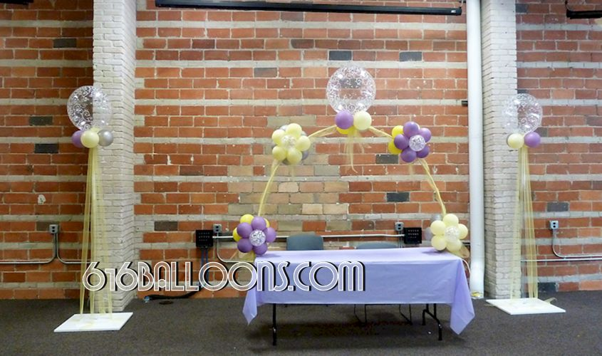 Elegant floral table arch and column with balloons and tulle for baby shower by 616Balloons.com Grand Rapids, Michigan. Specializing in high end balloon art & decor for the best corporate or private parties and events in West Michigan.