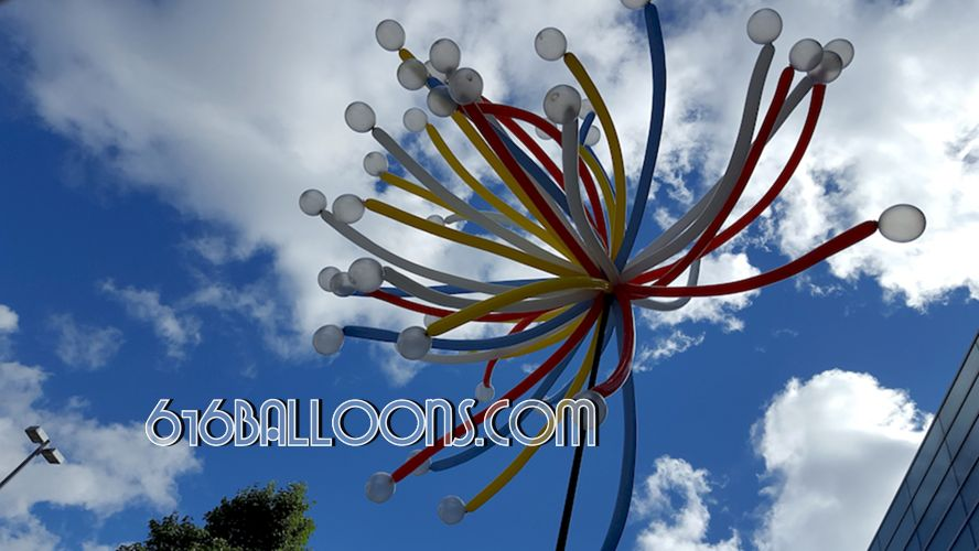 Firework column balloon sculpture by 616Balloons.com Grand Rapids, Mi. Premium balloon art & decor. Corporate events, private parties..