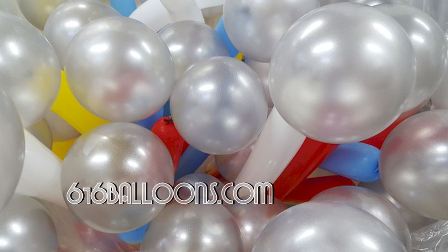 Close up firework column balloon by 616Balloons.com Grand Rapids, Mi. Premium balloon art & decor. Corporate events, private parties.